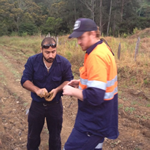 Taking initial soil samples for weather-proof road project