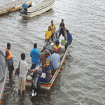Villagers prepare for 20 Klm boat ride back to village
